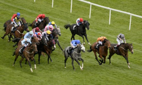 Gabrials Kaka and Jamie Spencer come with a withering run late and wide (right) to win at Newbury 12-4-14